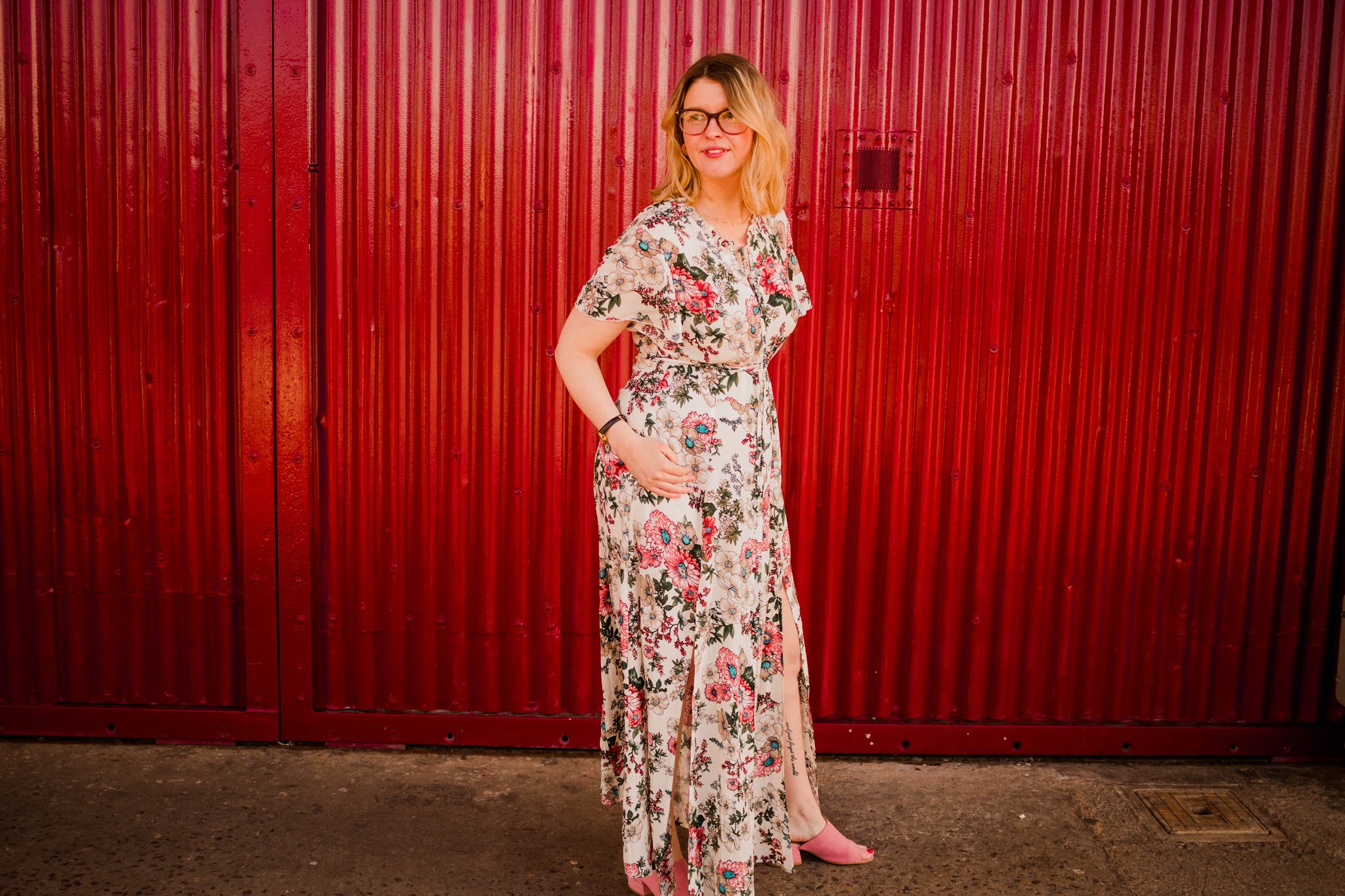 Fashion blogger wearing floral midi dresses. Wedding guest outfit inspiration