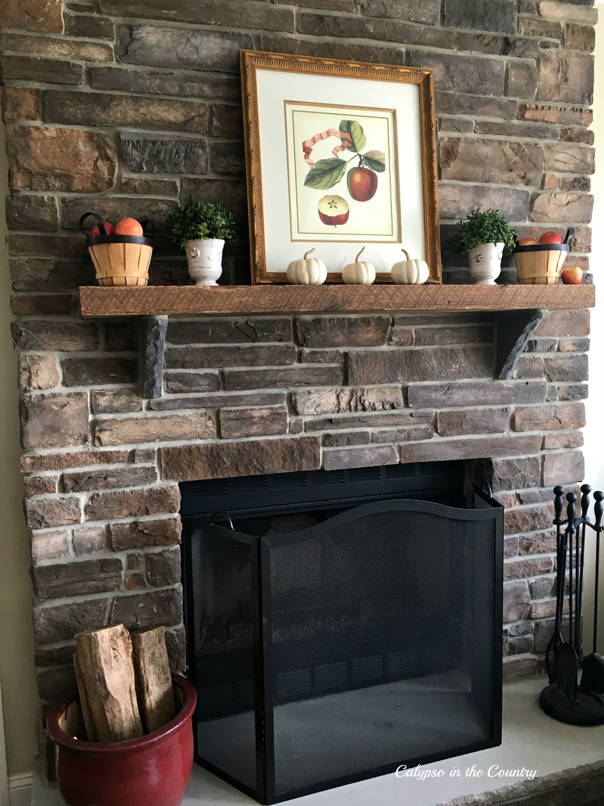 fall mantel with apples and white pumpkins calypso in the country
