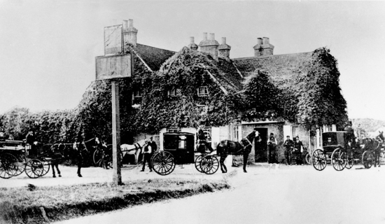 Photograph of The White Swan at Bell Bar. The licensee in 1891 was Charlie Chatman. It was open from 8am to 10pm. The stables contained two broughams, a wagonette, a Victoria, a trap and a dog cart which were used for taking people as far as Hertford
