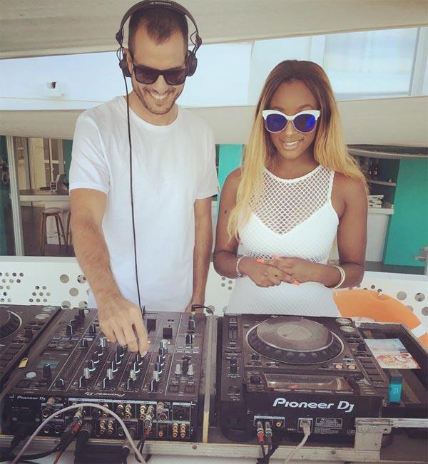 DJ Cuppy learns from veteran DJ in Spain