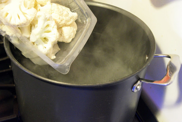 Cauliflower being added to the boiling water.