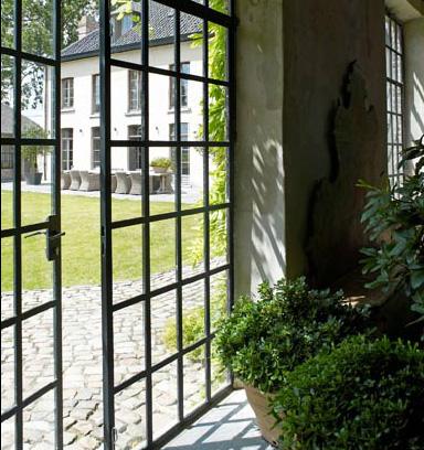 Iron and glass doors, Garnier orangerie via the Garnier (be) website as seen on linenandlavender.net