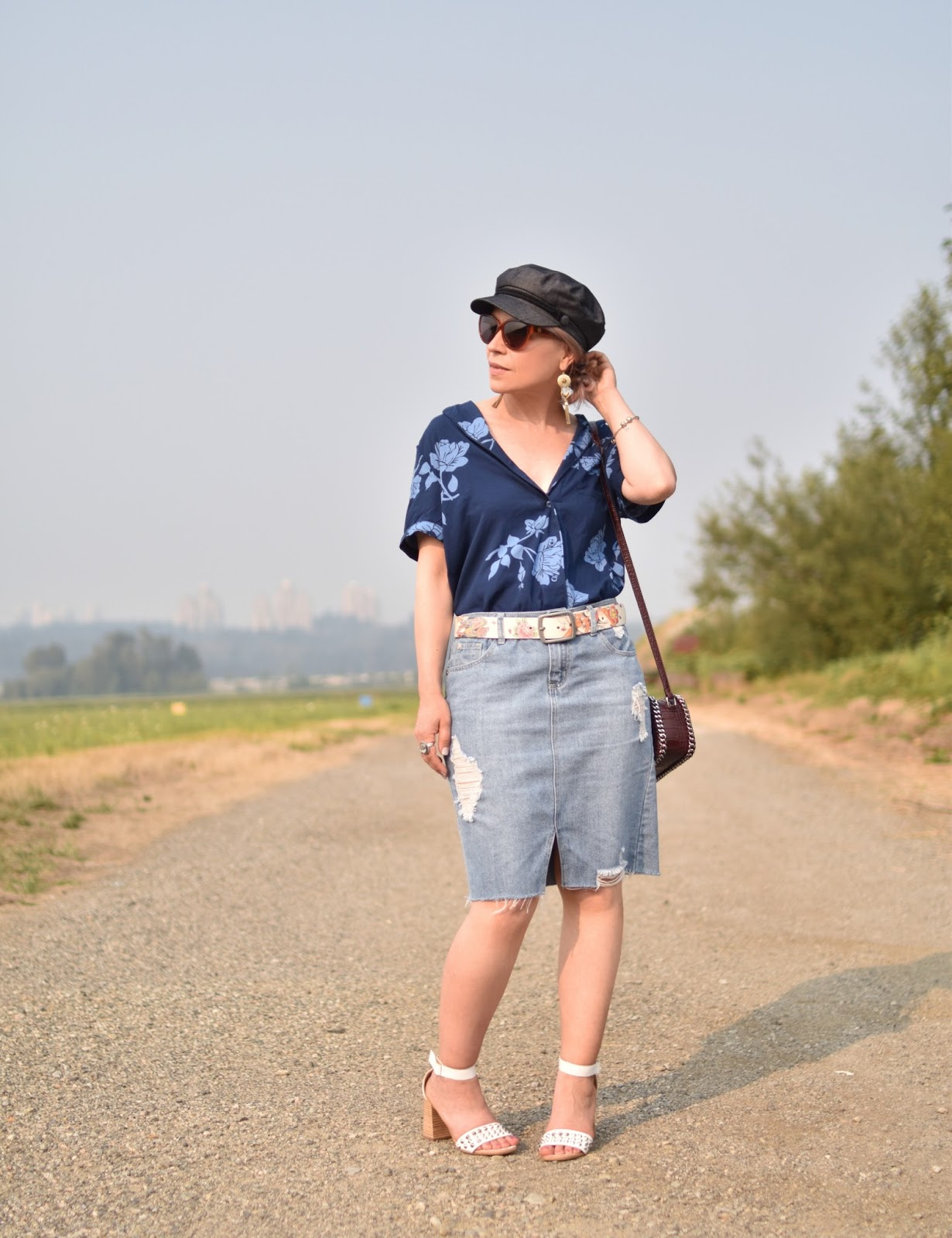 Monika Faulkner outfit inspiration - styling a pyjama top with a denim skirt, ankle-strap sandals, and a baker boy cap