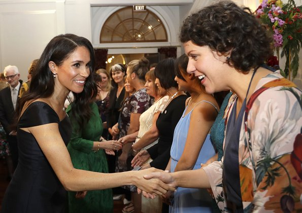 Meghan Markle wore a modified cap-sleeves navy dress by Gabriela Hearst and carried a navy leather clutch by Dior. Gabriela Hearst Navy Herve dress