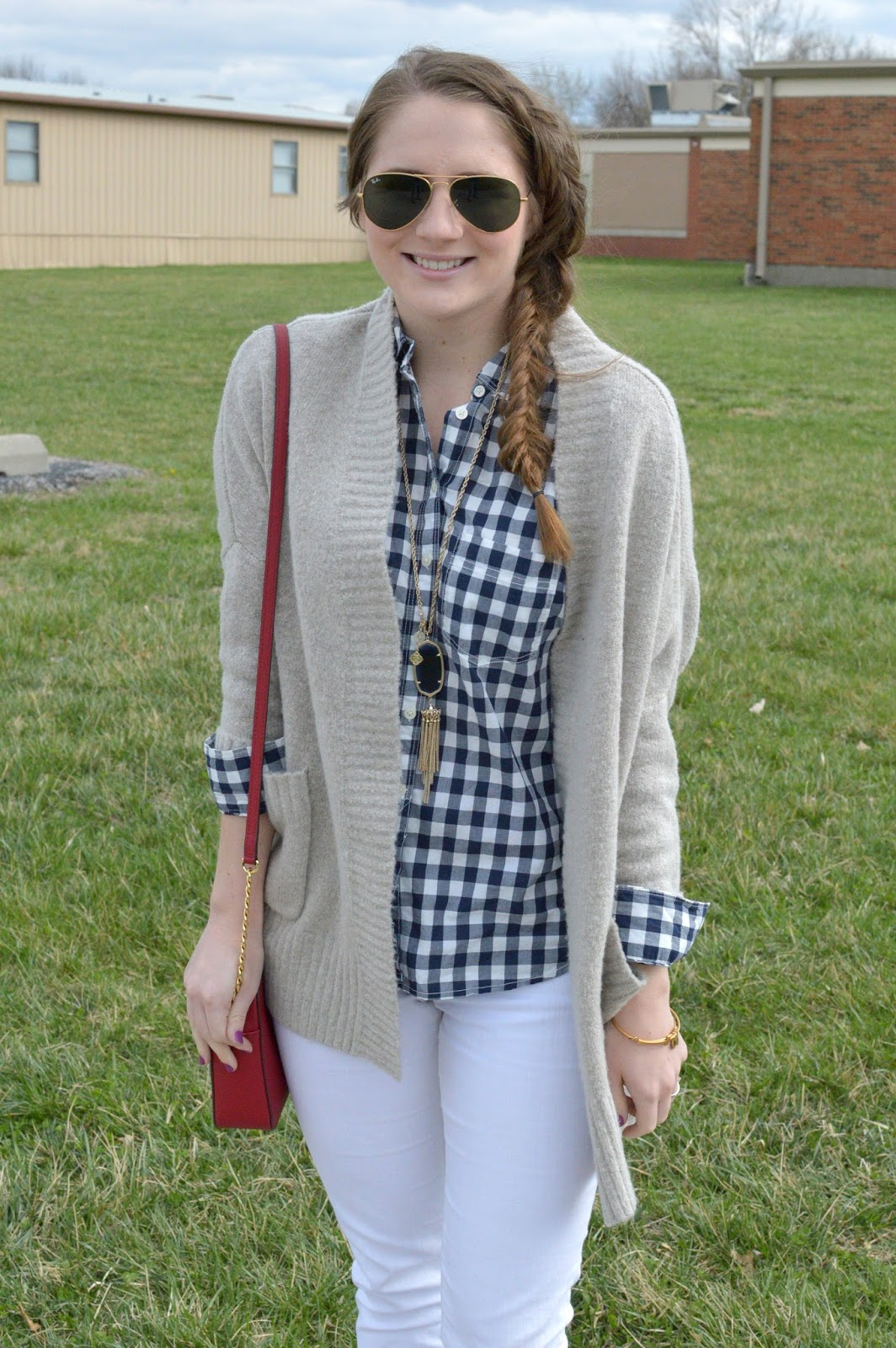 navy gingham top with a beige sweater and white jeans