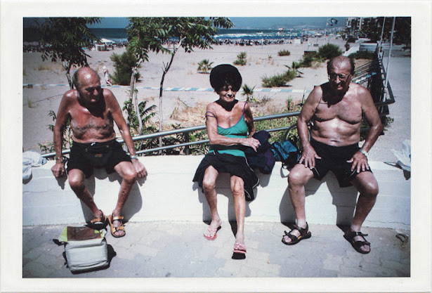 dirty photos - on the island of - photo of three old men with swimming coats at the beach