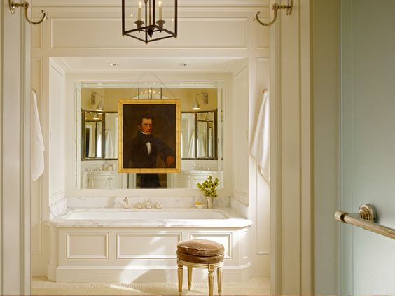 Luxury bathroom with tub and huge oil painting over it Ken Fulk