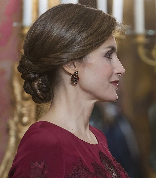 Queen Letizia attends the annual Foreign Ambassadors reception at the Royal Palace. Queen Letizia wore Felipe Varela Long sleeve dress in red diamond earrings hair