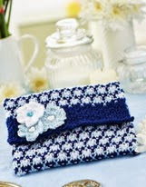http://www.letsknit.co.uk/free-knitting-patterns/clutch-purse