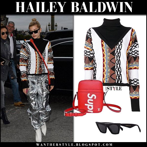 Hailey Baldwin in patterned sweater, silver pants and white boots in Paris september 28 2017 fashion week model style