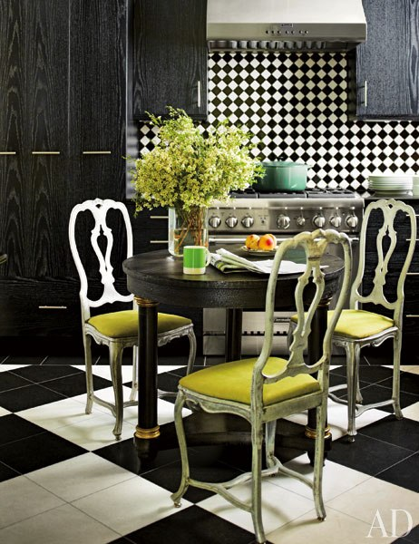 green chairs with checkered floor