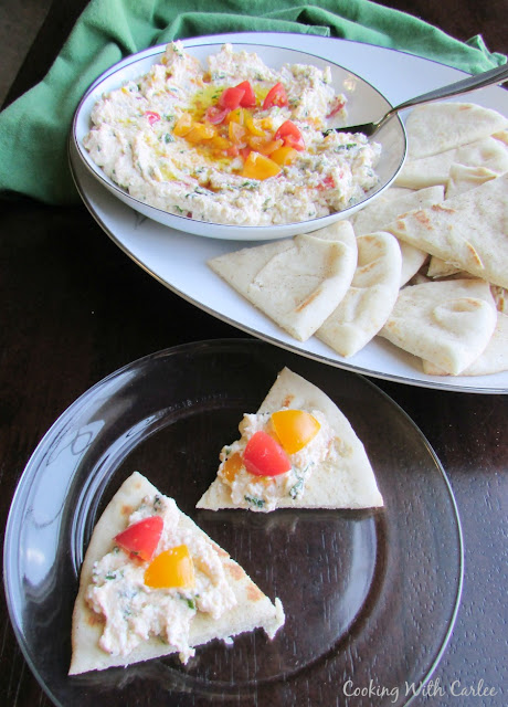 feta cheese spread on pita wedges ready to eat