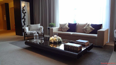 Living room with modern interior design with gray modern comfortable sofa bed with pillows and glass coffee table