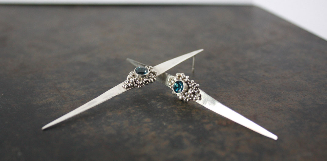 silver long earrings with topaz