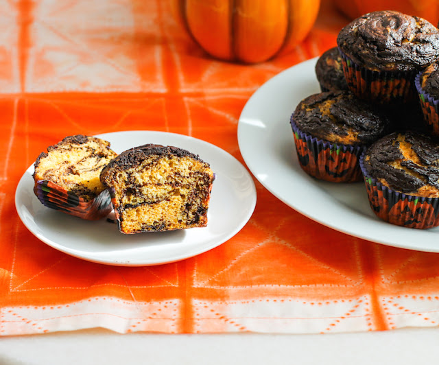 Food Lust People Love: Chocolate Pumpkin Swirl Muffins are my hat tip to the season, made with a cup of pumpkin and lots of rich dark chocolate. The pumpkin gives the batter a beautiful orange color and makes the muffins moist but the flavor is perfectly subtle. If you are throwing a Halloween party, you'll want to mix up a batch of these. The dark chocolate swirl and the orange pumpkin batter will be a hit on your holiday table.