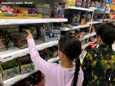Children looking at toys in Asda