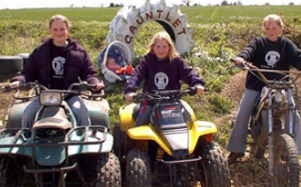 There girls on quad bikes and motorcycles