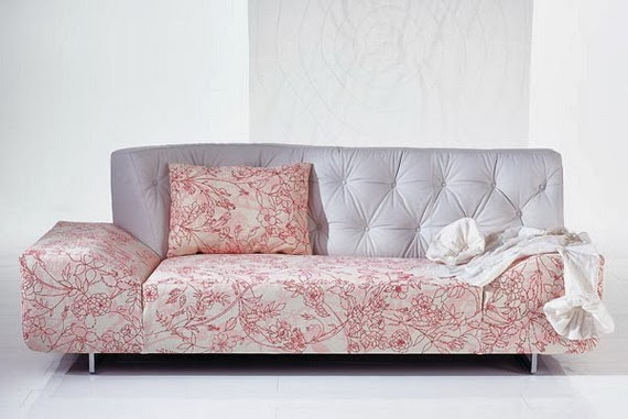 Sofa patterned on a plain room.
