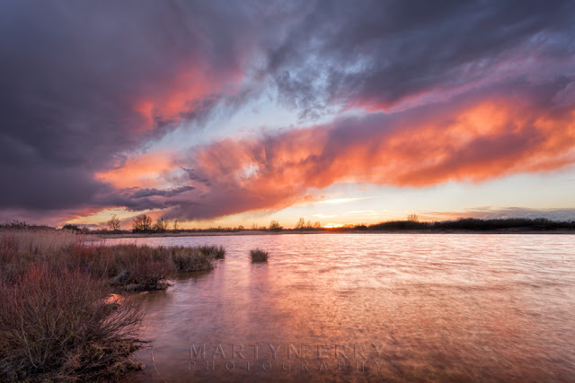 Clouds at sunset in the Cambridgeshire Fens at Ouse Fen Nature Reserve