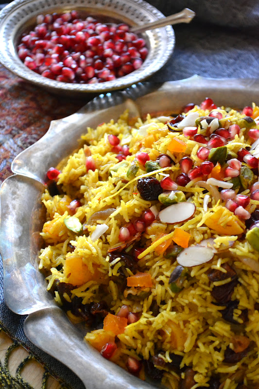 Persian jeweled rice on a platter with pomegranates