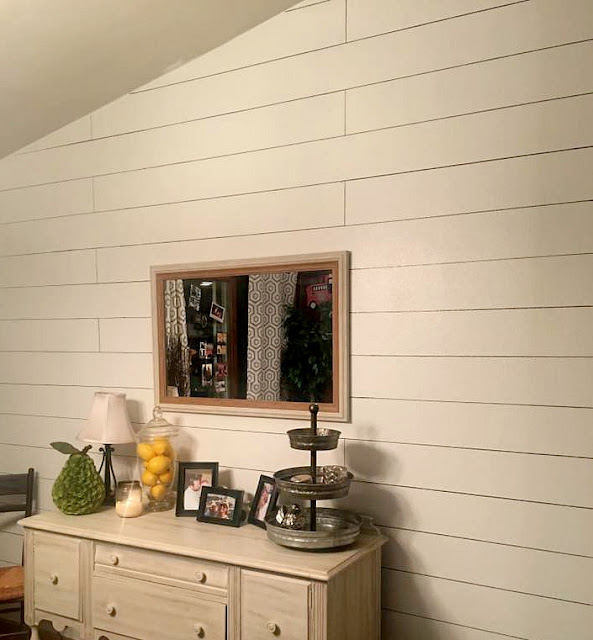 Painted shiplap wall with sharpie
