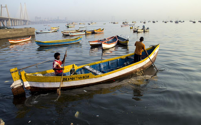 fishermen boat rowing arabian sea worli jetty mumbai koliwada india