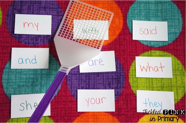 sight word flashcards on a rug with a fly swatter over 1 word