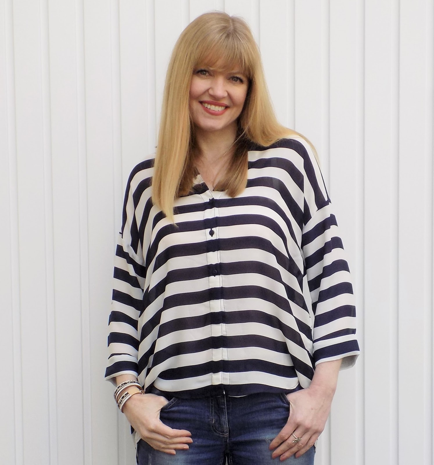 Navy striped dipped hem shirt with boyfriend jeans and leopard print heels