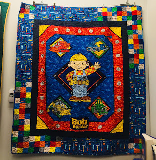 A Bob the Builder Quilt Hanging on Display at the Library