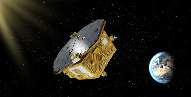 An artist's rendering of LISA Pathfinder on its way to Earth-sun L1. Credits: ESA/C. Carreau