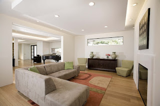 Gorgeous Grey Modern Sofa Bed on the Unusual Carpet and Hardwood Floor under the White Ceiling