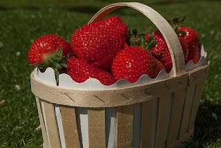 Fresh, Ripe Strawberries in a Wooden Basket