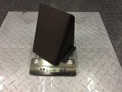 Bespoke Carbon Caterham fuel pipe cover weighs 86g