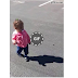 Little girl gets scared of her own shadow