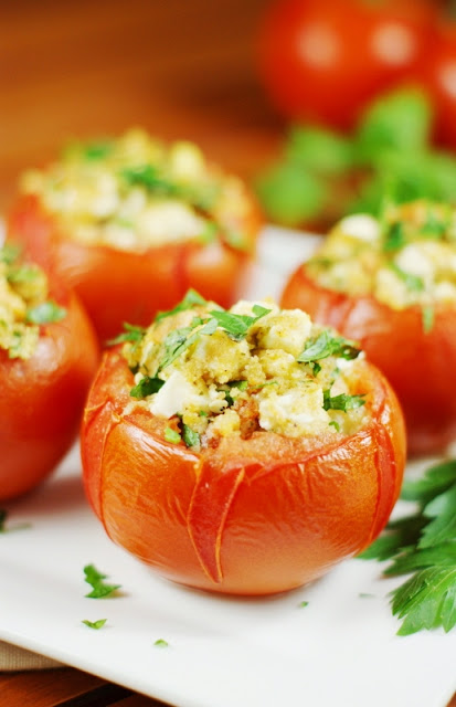 Baked with a flavorful feta cheese and fresh parsley filling, these Feta-Stuffed Tomatoes are sure to please.  Not to mention, they're a great way to eat up those oodles of garden tomatoes coming out your ears!   www.thekitchenismyplayground.com