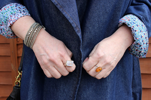 Moonstone Ring, Amber Ring, Grey Spiral Bracelet against Denim Coat | Petite Silver Vixen