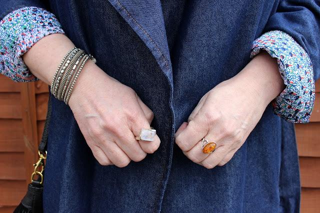 Moonstone Ring, Amber Ring, Grey Spiral Bracelet against Denim Coat | Petite Silver Vixen