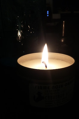 A candle that smells like tobacco, coffee, gun oil and Old Spice