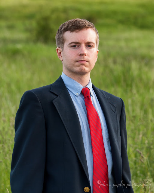 Outdoor professional headshot portrait of a college graduate