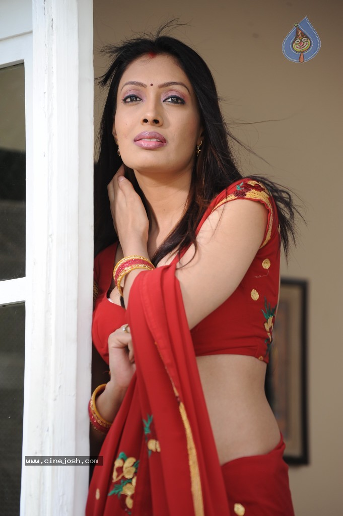 Surabhi Hot Cleavage In Red Saree