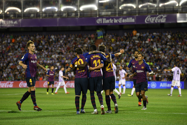 Lionel Messi and Players of Barcelona celebrates after Ousmane Dembele scores the first goal during the La Liga match between Real Valladolid CF and FC Barcelona at Jose Zorrilla on August 25, 2018 in Valladolid, Spain.