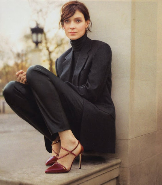 woman in black suit and burgundy high heels