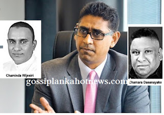 Faiszer Musthapha and Chaminda Wijesiri in heated Parliament argument