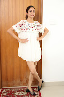 Lavanya Tripathi in Summer Style Spicy Short White Dress at her Interview  Exclusive 258.JPG