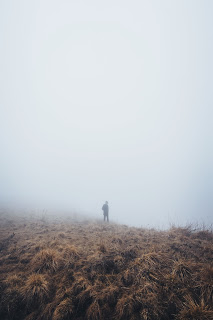 When God isn't there - small man in field on foggy day