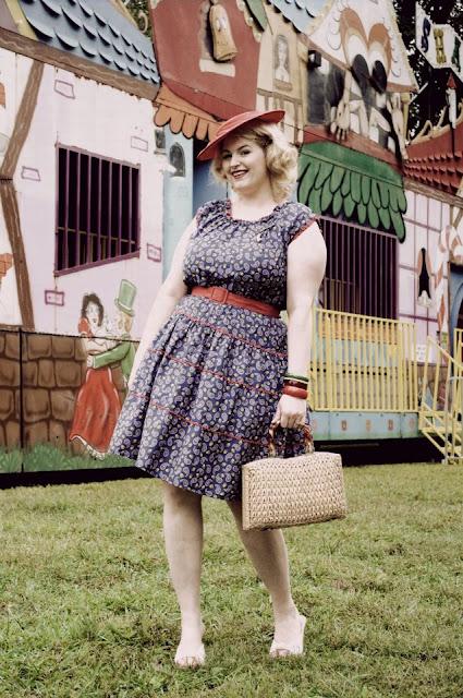 1950s vintage plus size fashion with red straw hat, lucite wicker purse, bakelite bracelets via Va-Voom Vintage