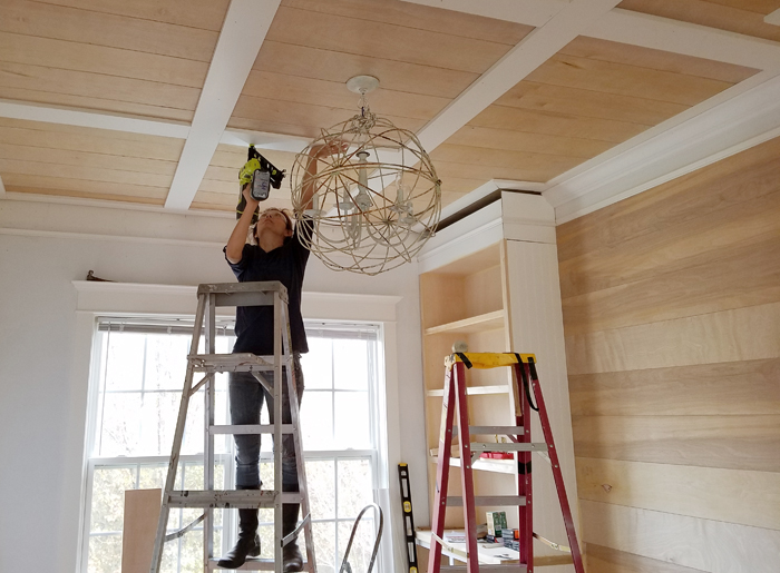 Ryobi pneumatic nailer used by Cristina Garay to drive nails to beams on ceiling