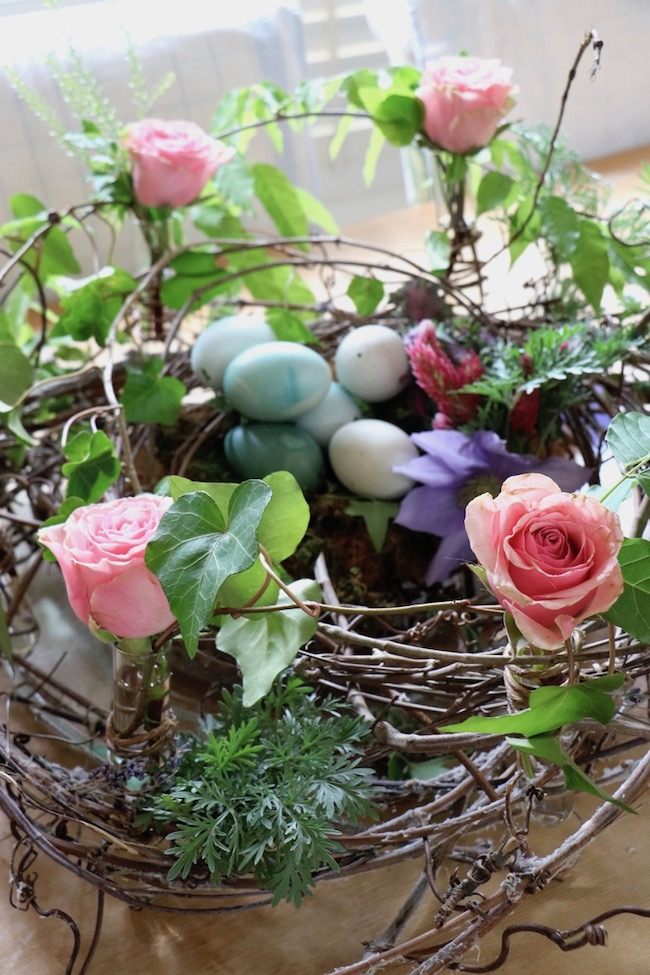 Spring celebration grapevine bird nest centerpiece with fresh flowers