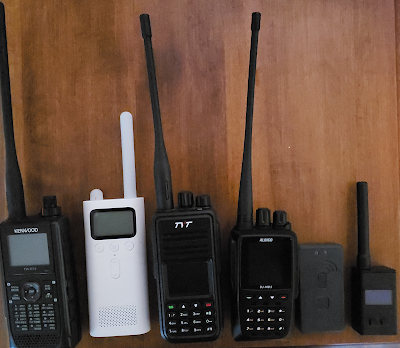 Pictured Left to Right  - Kenwood TH-D74, Xiaomi Mijia,  TYT MD-UV380, Alinco MD-5TGP, Mobilinkd TNC2 and PicoAPRSv2