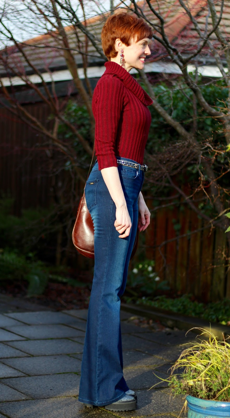 Side view of flared jeans outfit, over 40 | Fake Fabulous